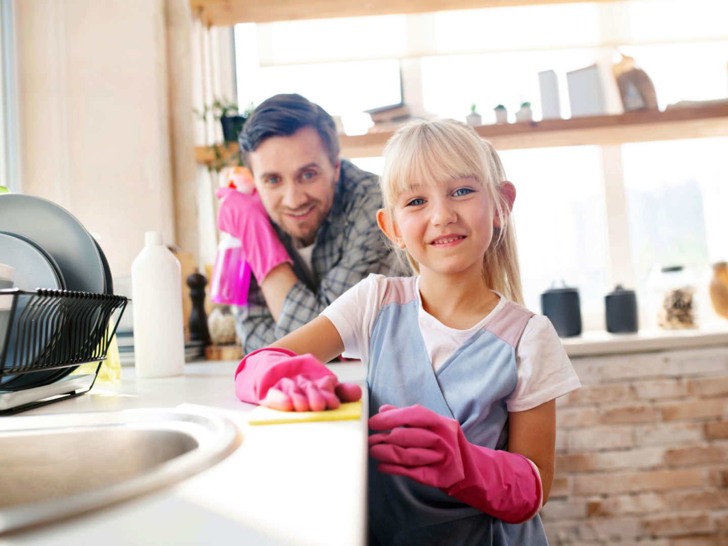 Child cleaning with parent - Germs and Cleaning | NSF International