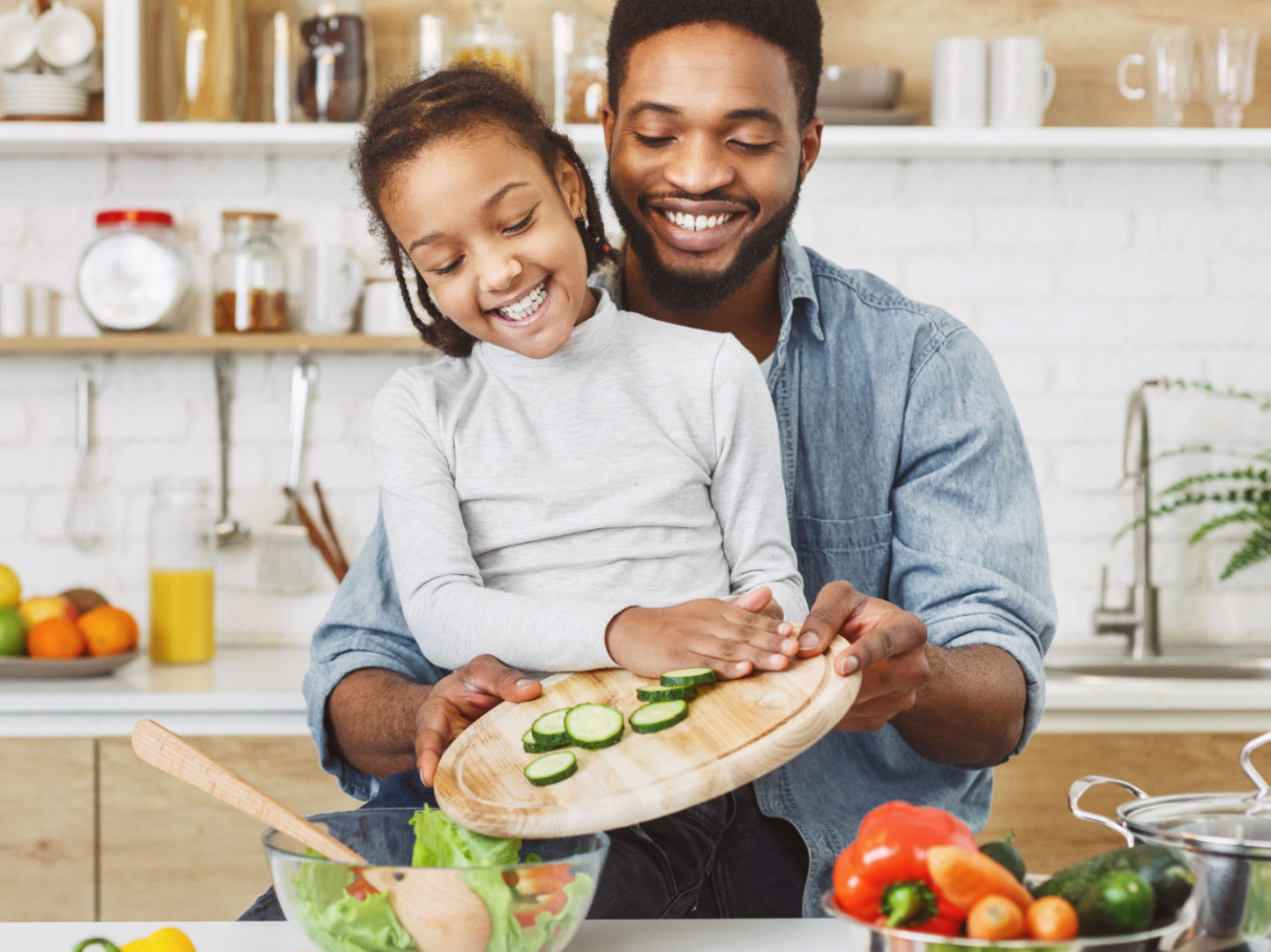 Father and daughter making salad - Organic Food   NSF International