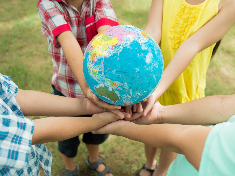 Kids hands holding globe