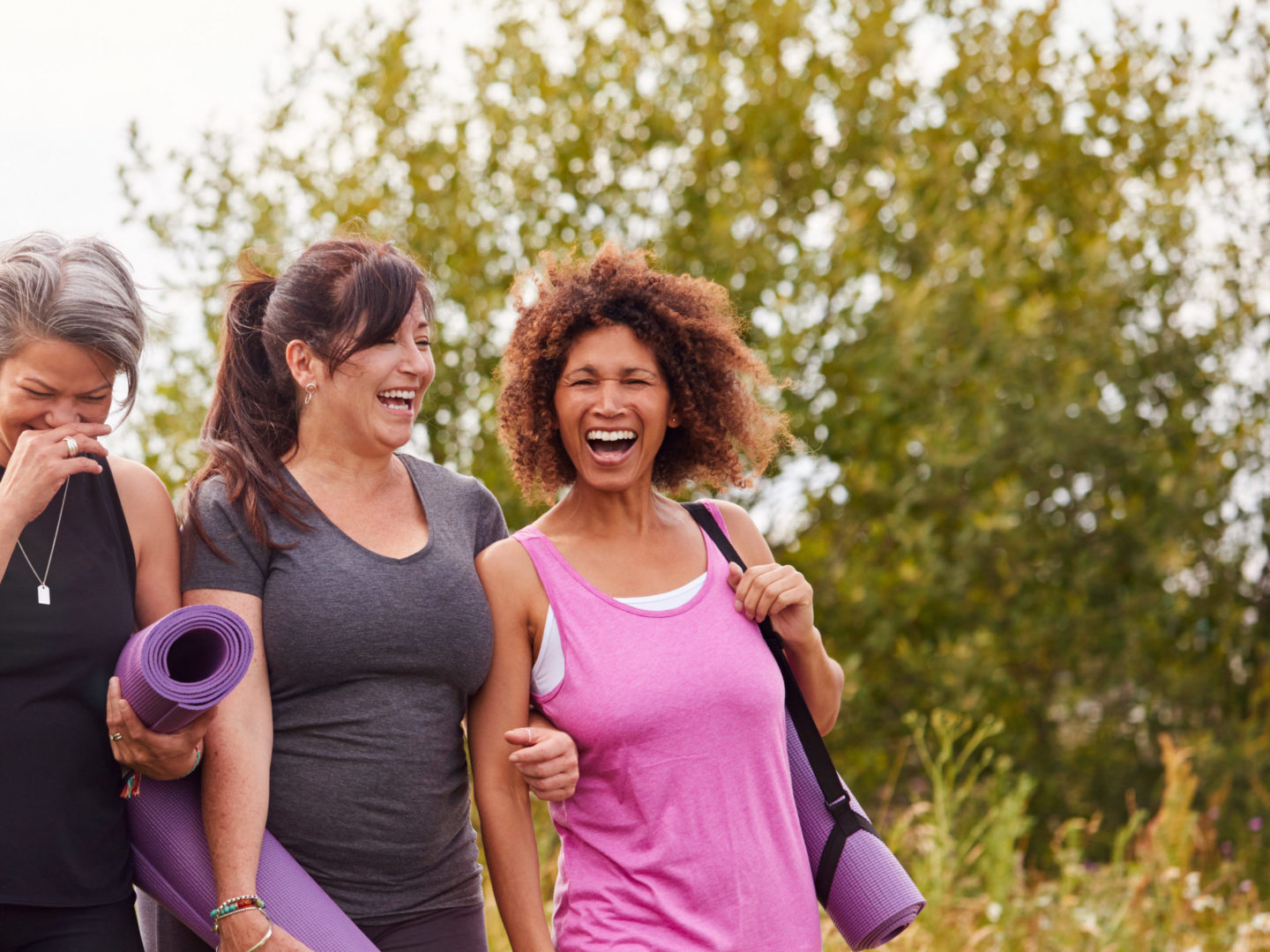 Group of Mature Female Friends on Outdoor Yoga Retreat Walking along Path - Health Consultation Services | NSF International