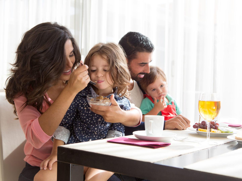 Parents feeding children - Food Safety | NSF International