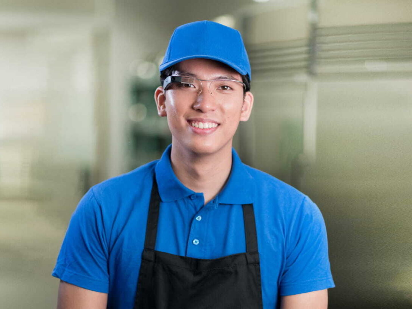 Man in restaurant wearing smartglass - Augmented Reality Training and Remote Assistance | NSF International