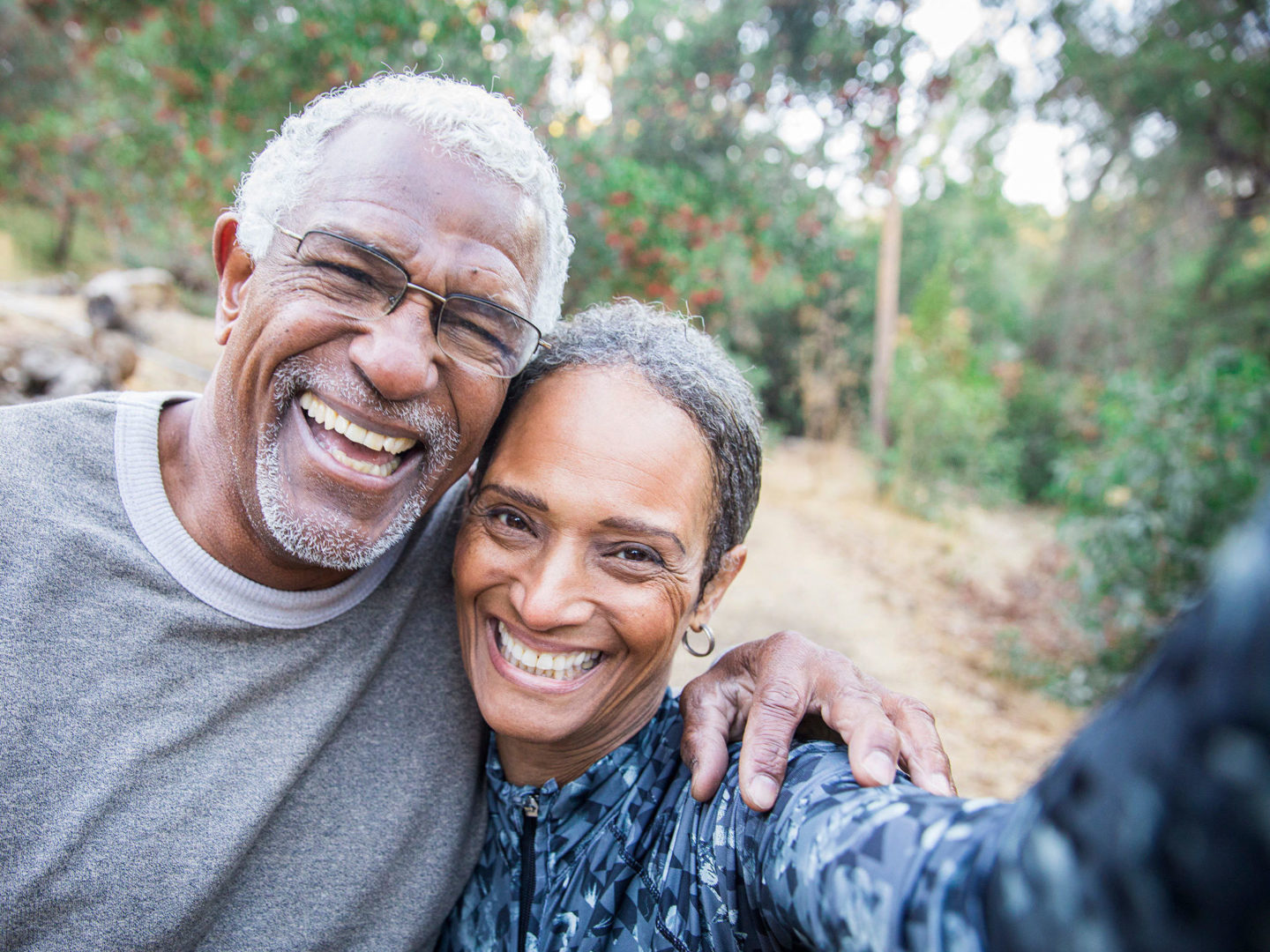 Older Couple Takes a Selfie during their Workout - Health Certification Services | NSF International