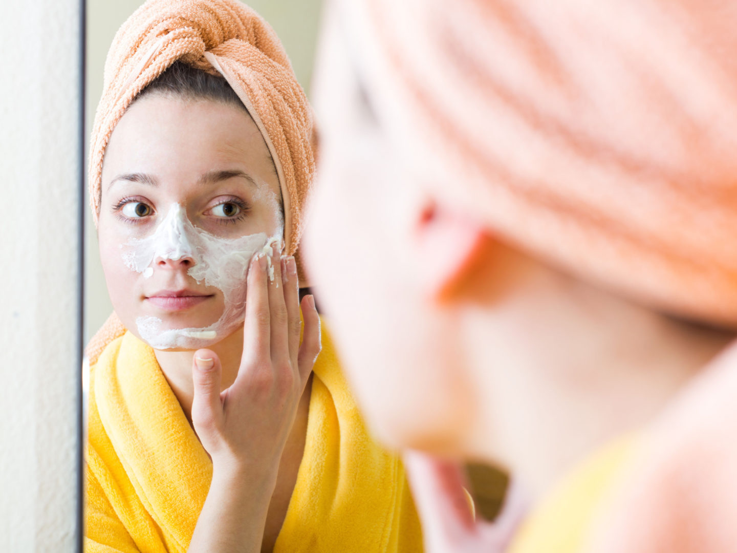 Woman applying face cream - Cosmetics and Personal Care   NSF International