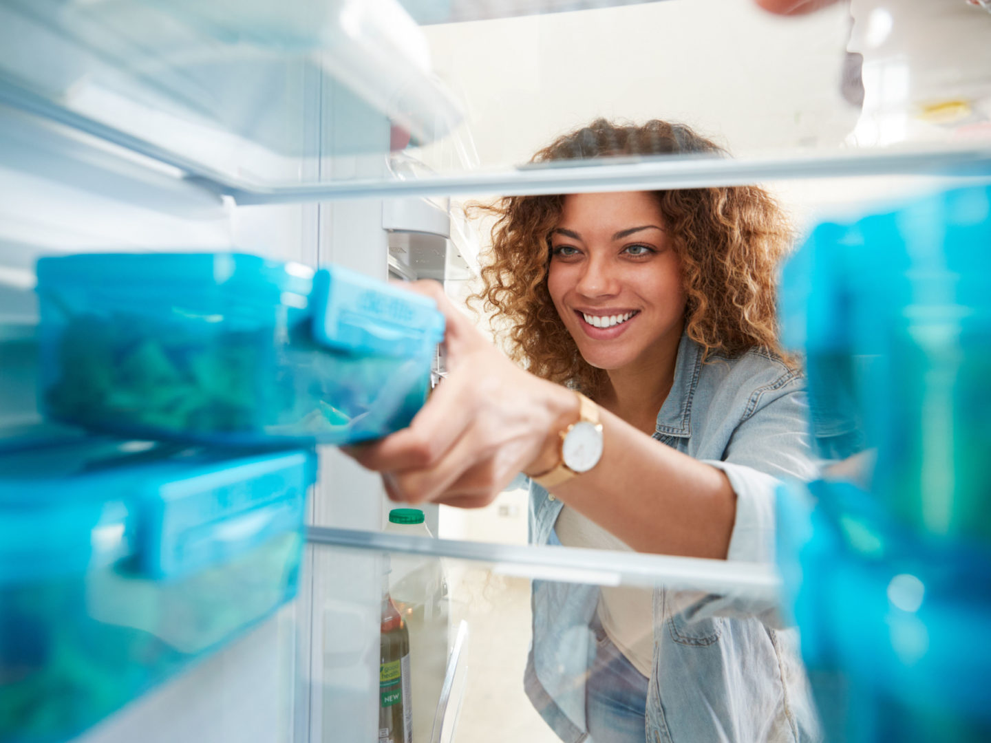 Woman removing ingredients from refrigerator - Cooking | NSF International