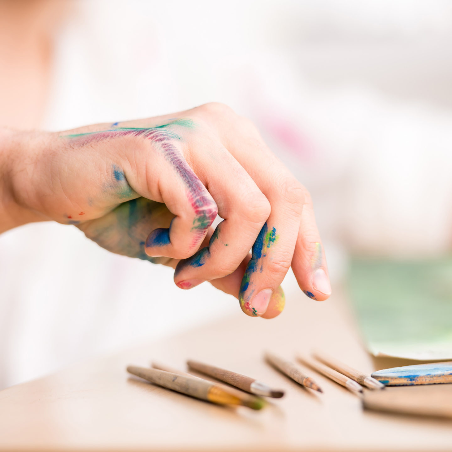 Artist's hand with paint on it - The New CMMC Requirements: It's Not Abstract Art | NSF International