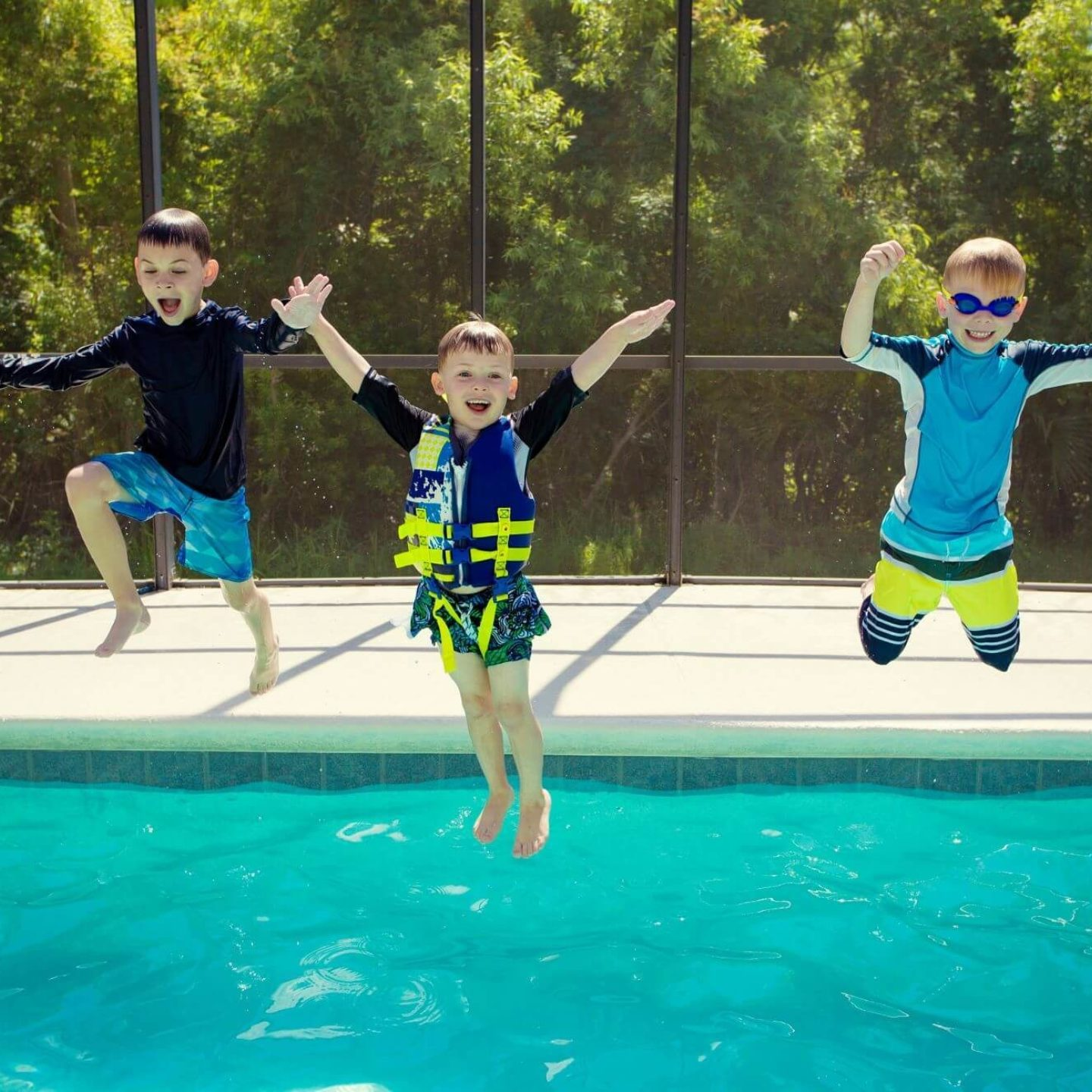 Young boys jumping into pool - Swimming Pool Safety Tips   NSF International