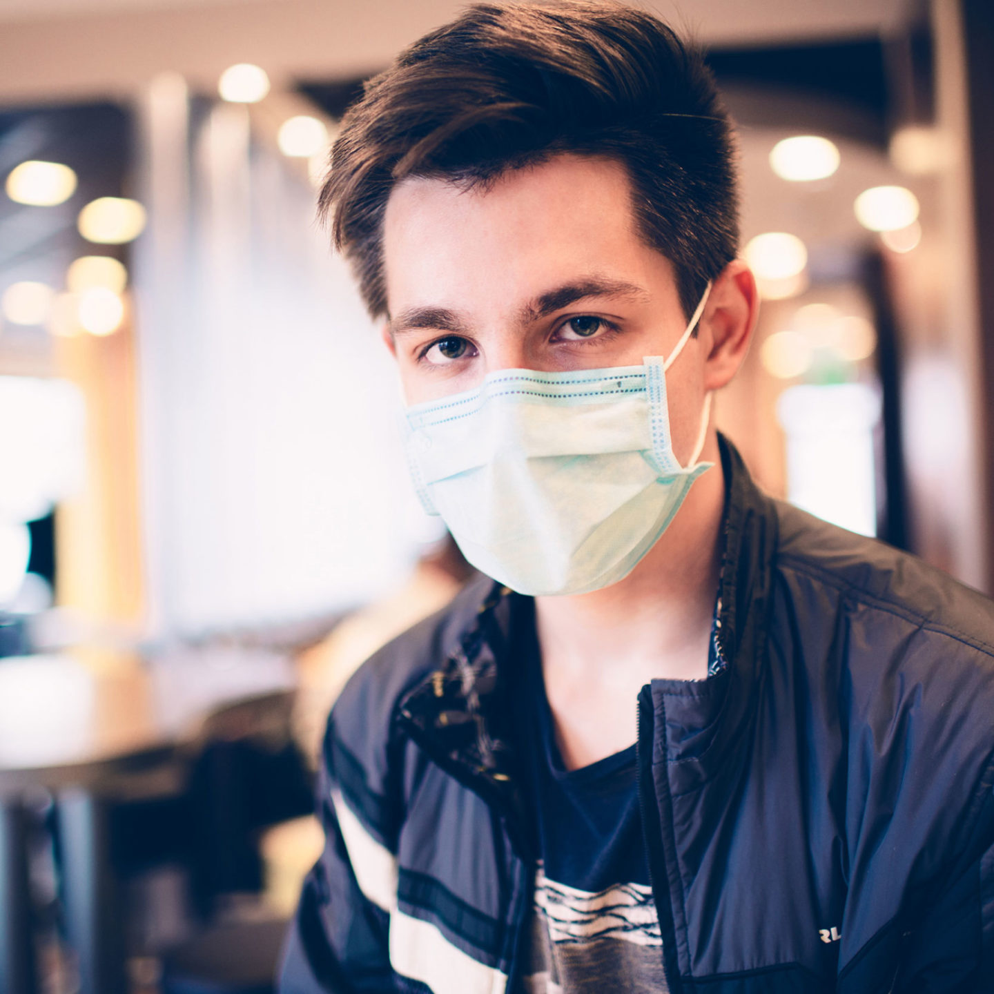 Male customer in a restaurant wearing a face mask