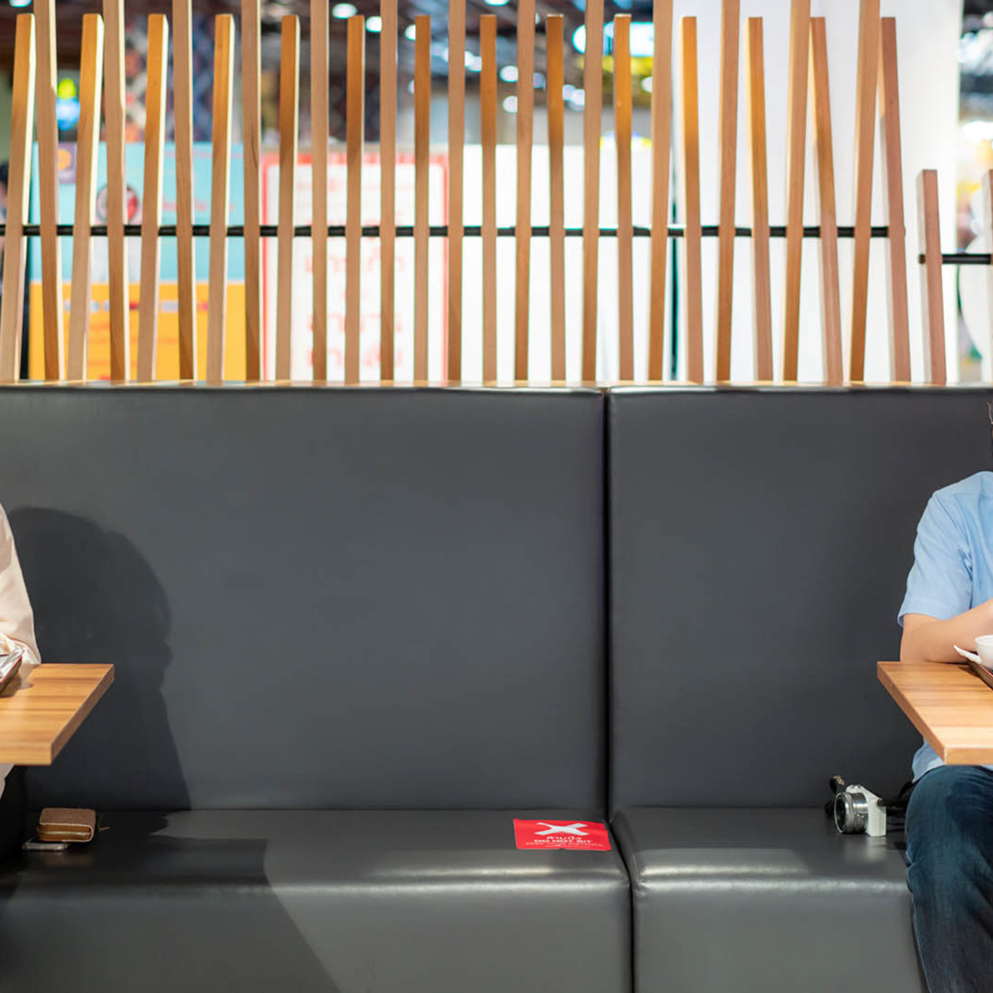 Two people sitting in dining room