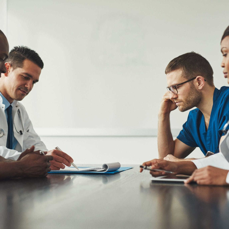Doctors meeting in a room