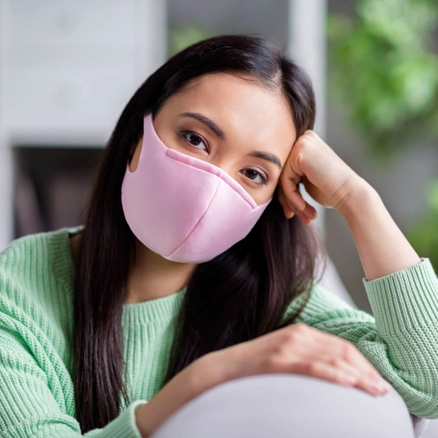 Woman wearing pink mask - Easing Back Into Public Places and Social Spaces   NSF International
