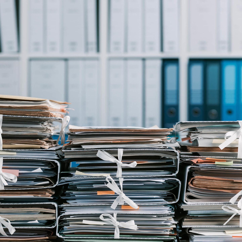 Stacks of folders with ties