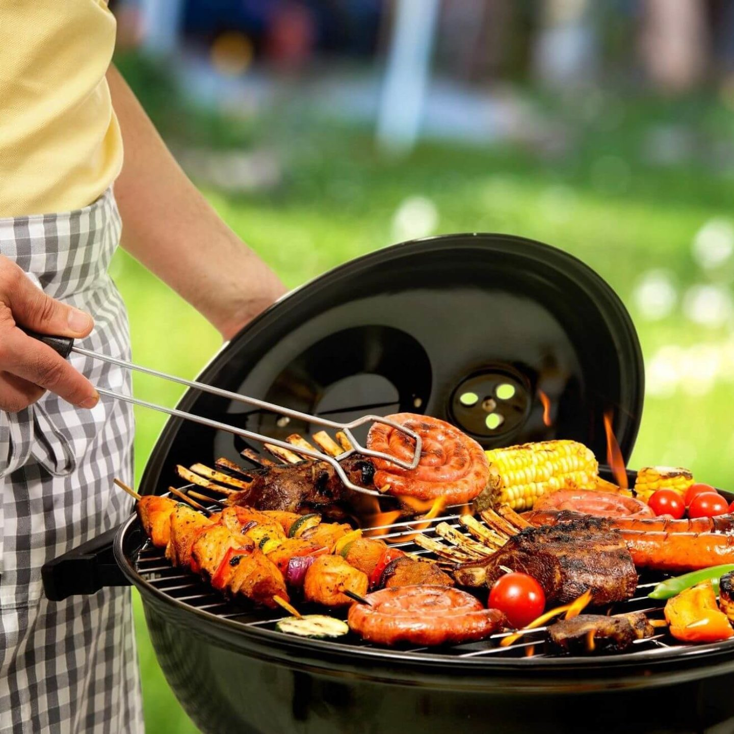Barbecue grill with meat and veggies - Guide to Safely Firing Up the Barbeque | NSF International