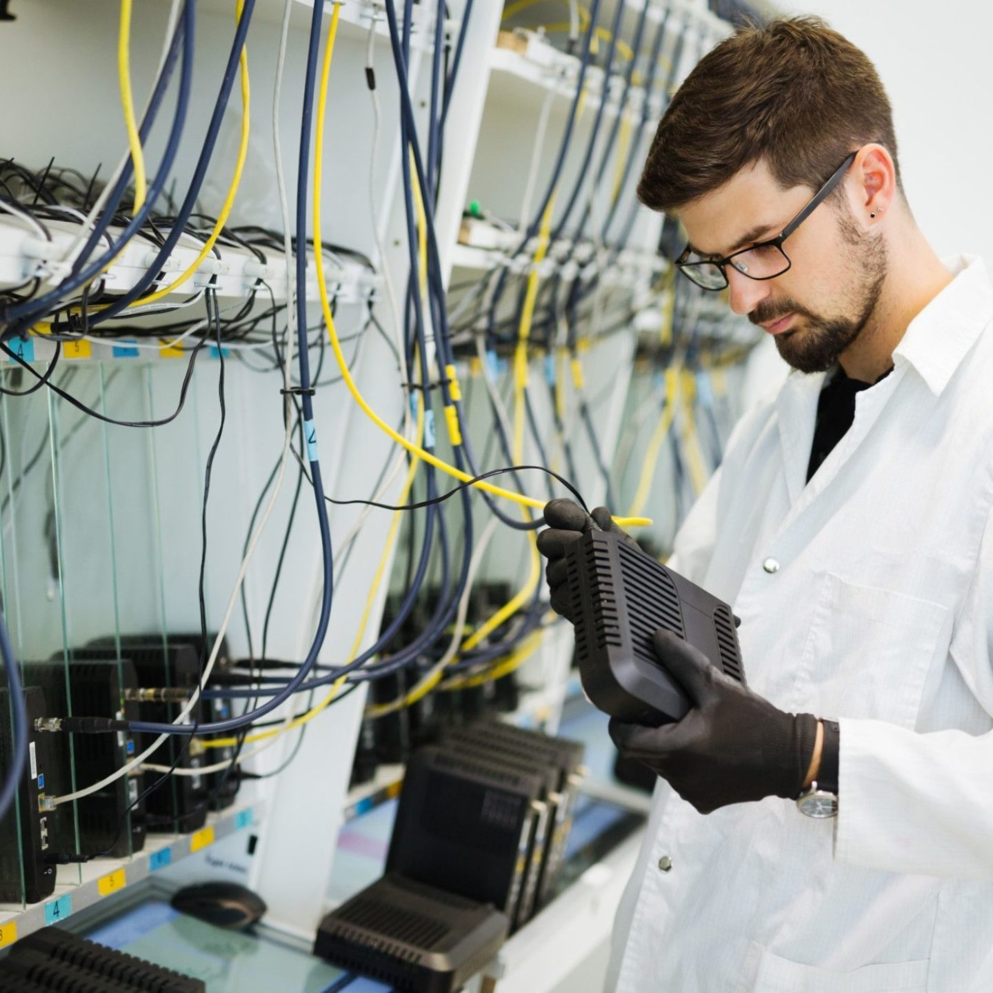 Man plugging in network wires - NSF-ISR's Provides Full ISO/IEC 27001 Certification Remotely | NSF International