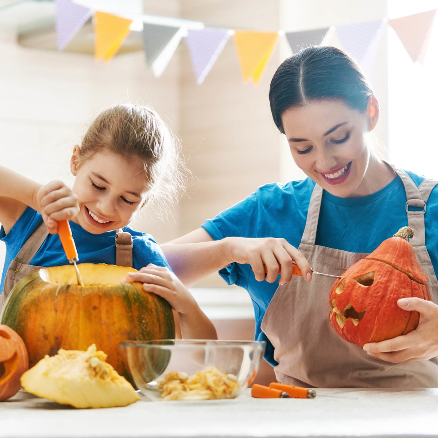 Mother and daughter carving pumpkins 108423489