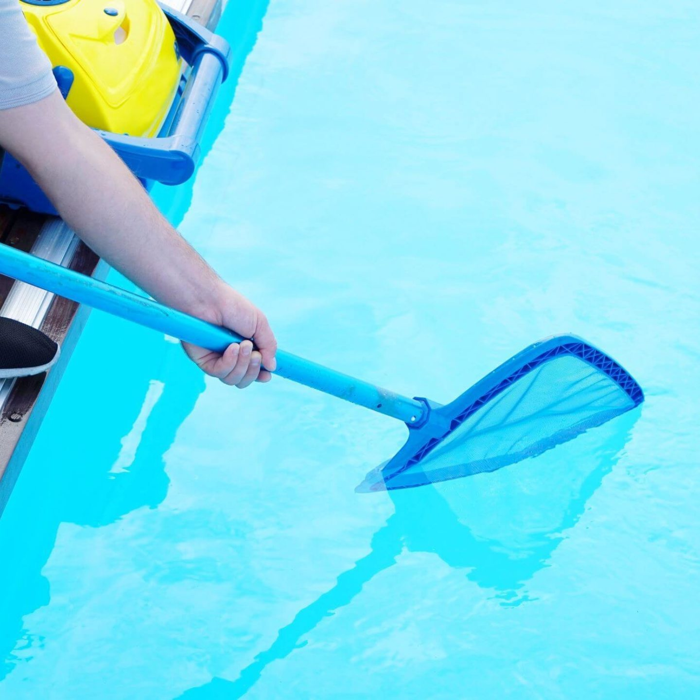Person cleaning pool - Keep Your Swimming Pool Clean and Safe | NSF International