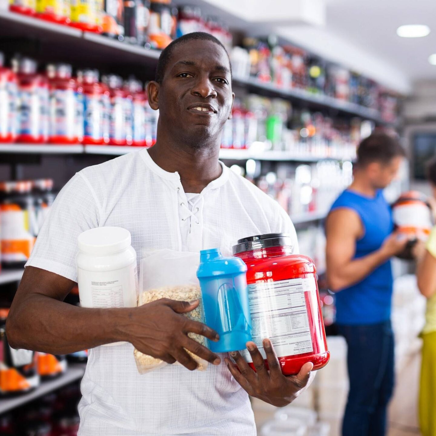 A man with sport nutrition products - Beware of Banned Substances in Sports Supplements | NSF International