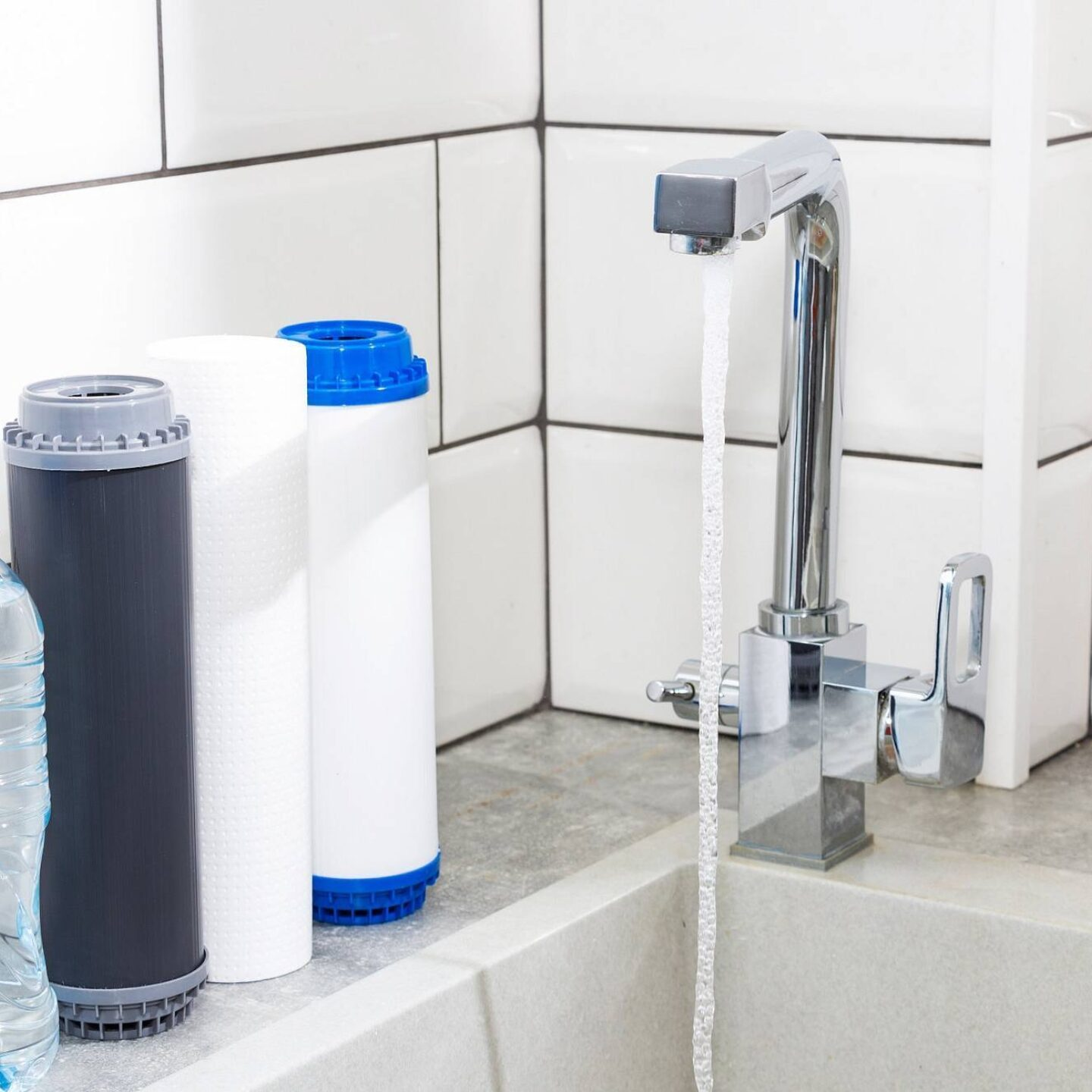 Running tap water - Tips to Treat PFAS Chemicals in Your Drinking Water | NSF International