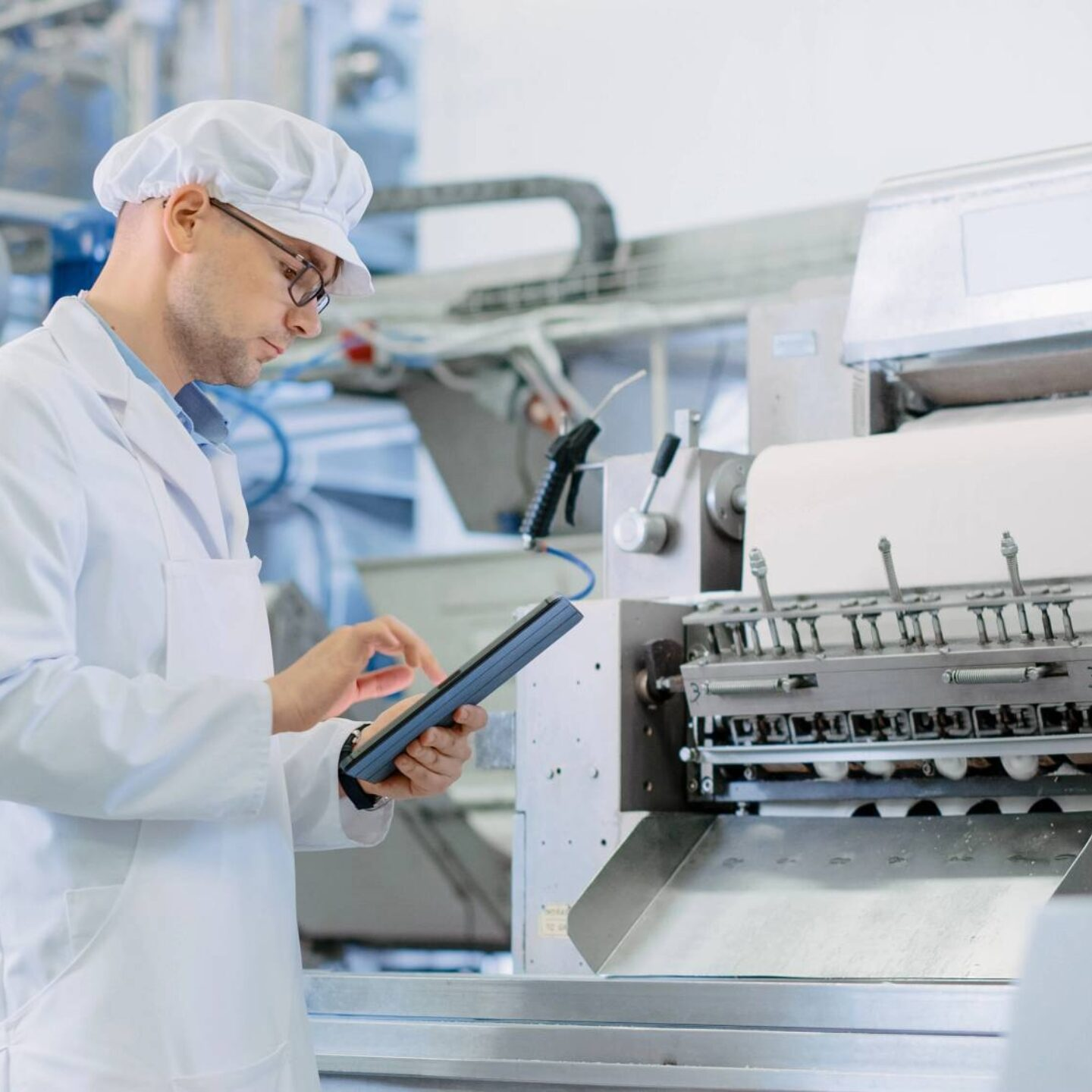Male technician working with tablet in automated factory - What Makes a Lubricant a Food-Grade Lubricant | NSF international