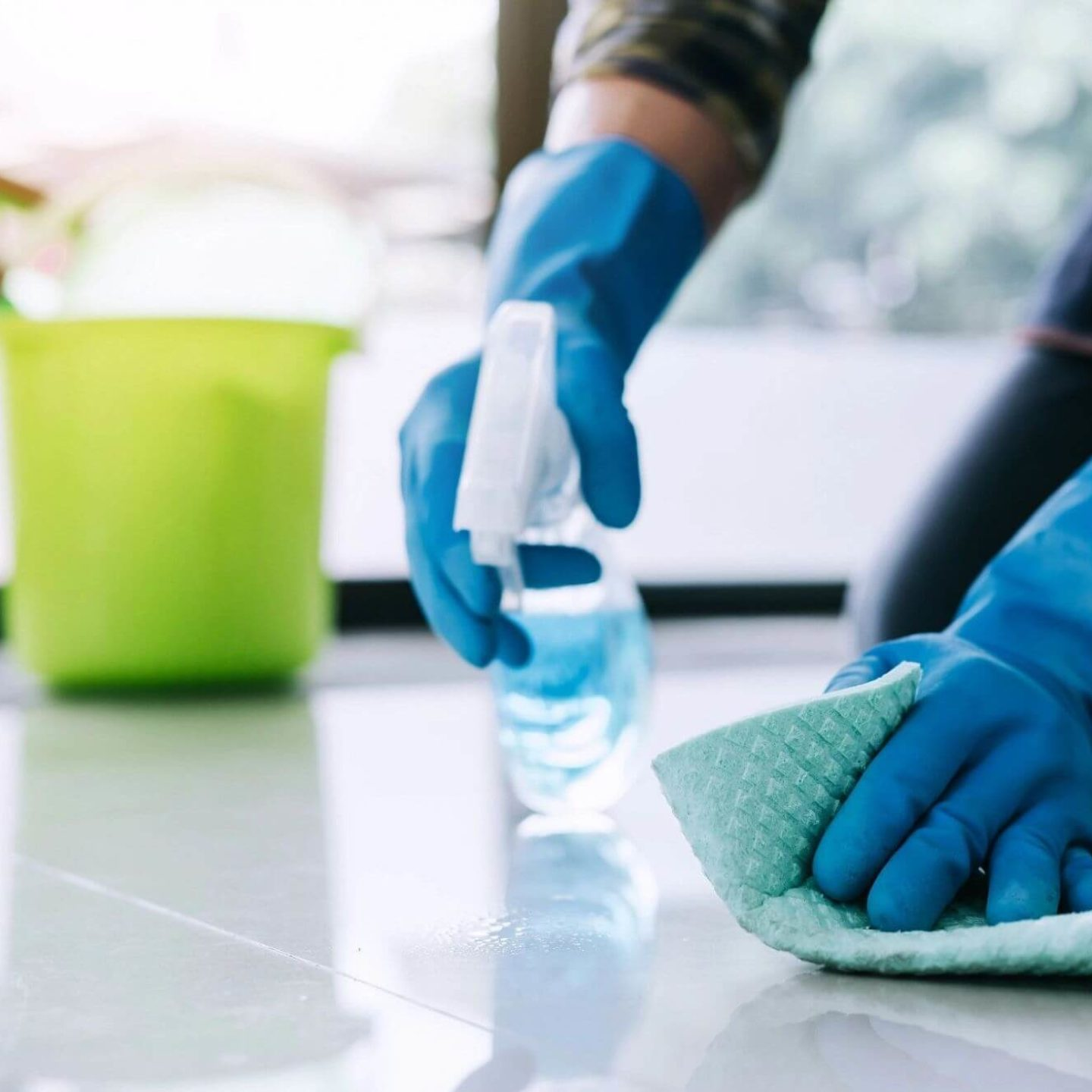 Person cleaning floor - Spring Cleaning: What's the Difference Between Cleaning, Disinfecting and Sanitizing? | NSF International