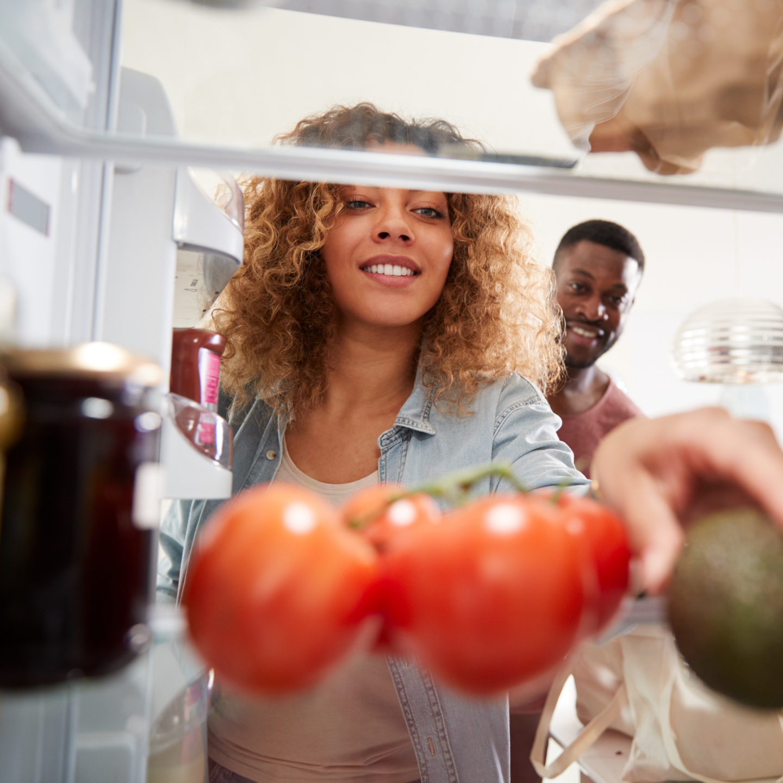 Woman searching in fridge