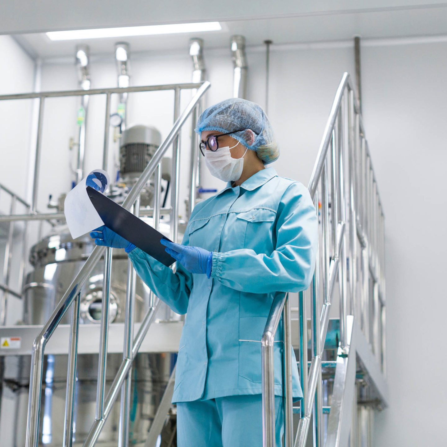 Woman in lab reviewing clipboard