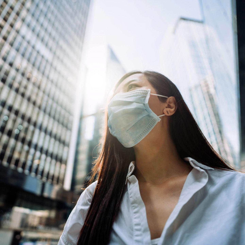 Woman wearing mask in city