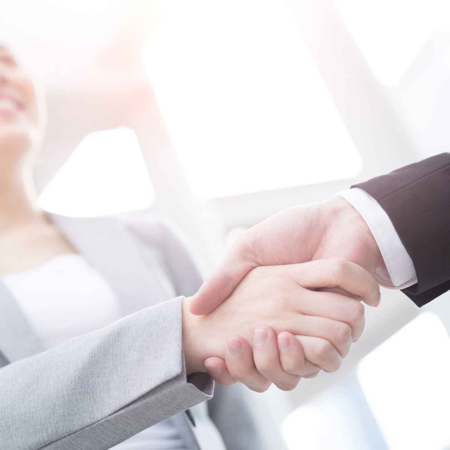 A female company manager shaking hands with her colleague - Remediation of Pharmaceutical Quality Systems | NSF International