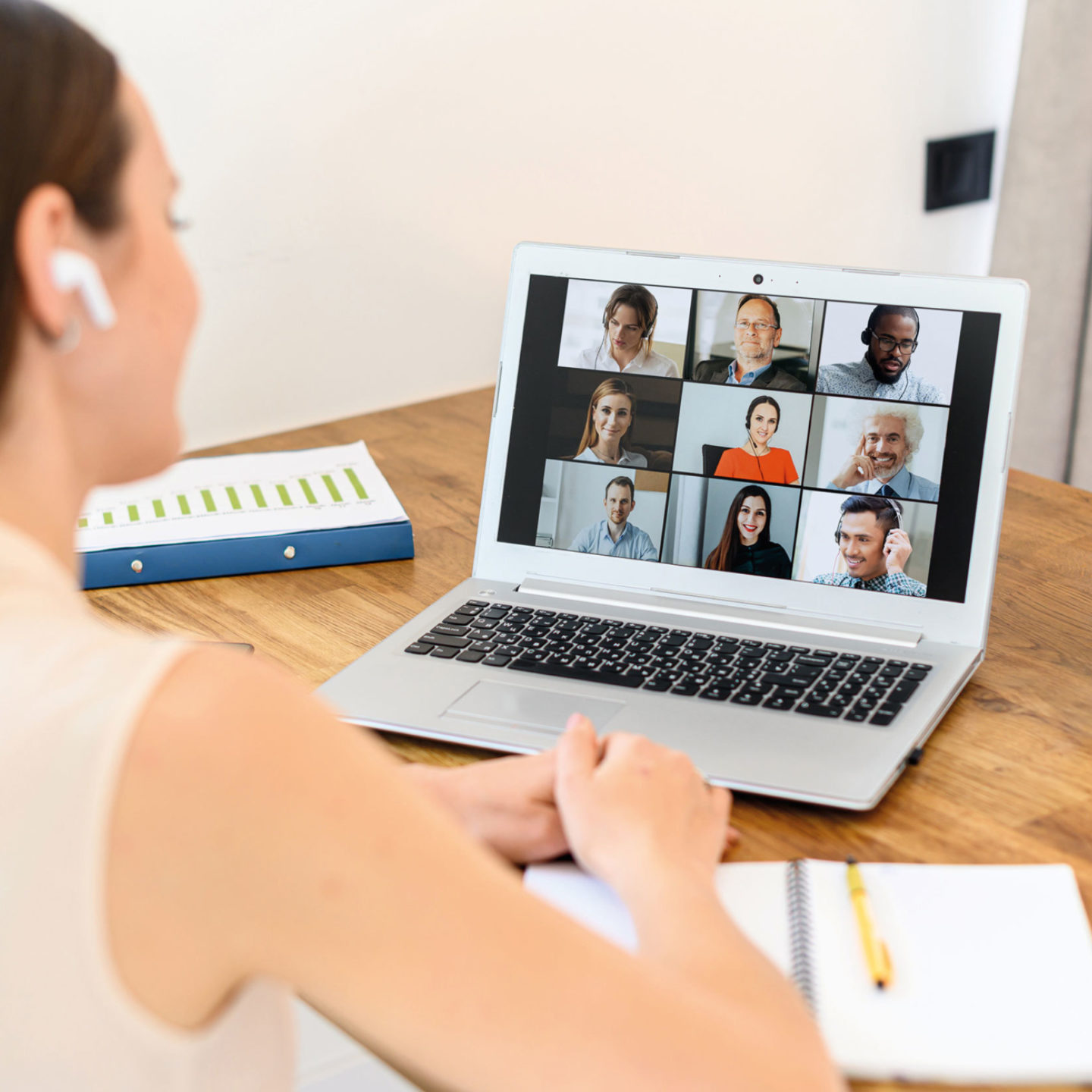 Woman taking a virtual training on her laptop