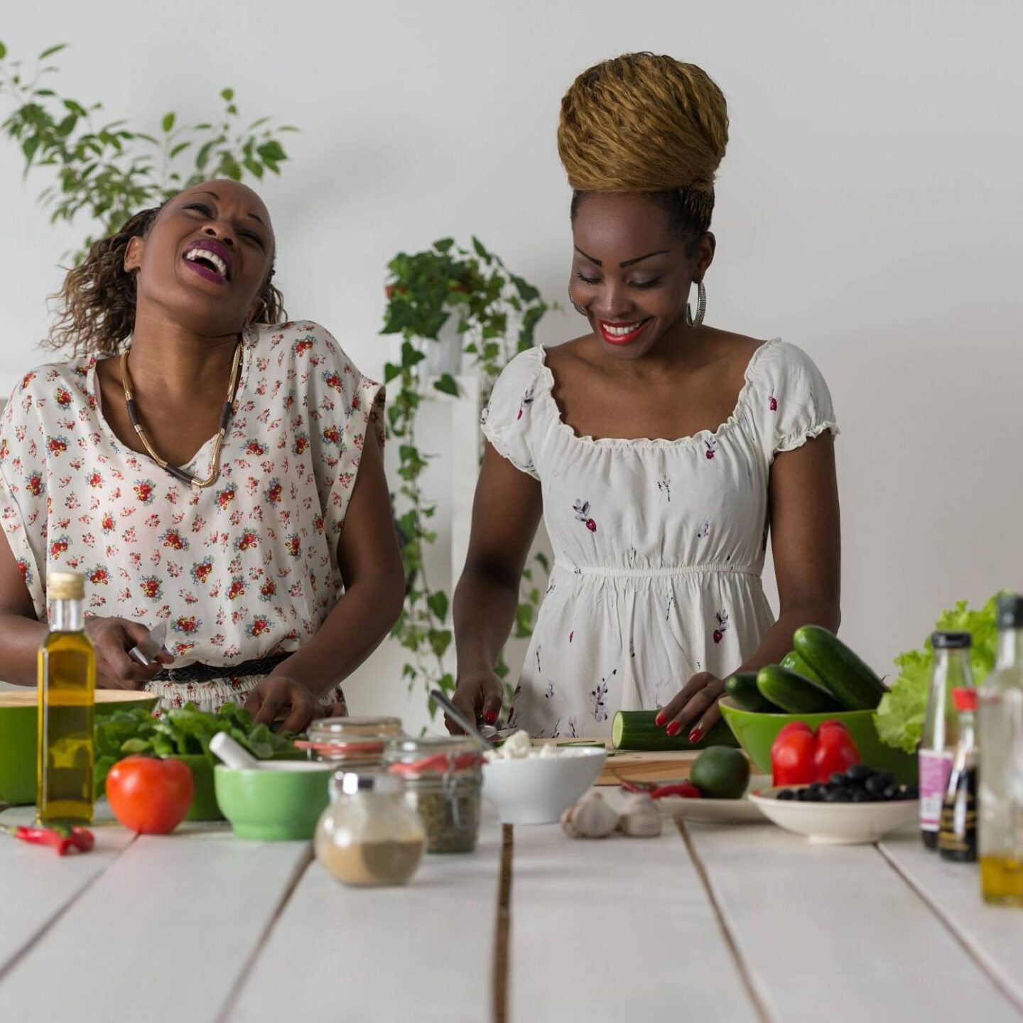 Two women cooking in kitchen making healthy food-Top 5 Cooking Safety Tips for Home Kitchen | NSF International