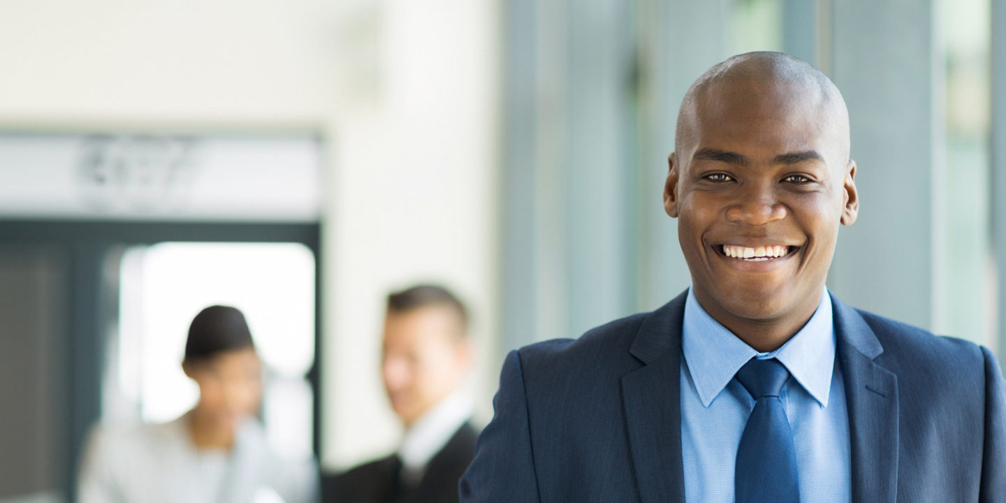 Young african american businessman in office