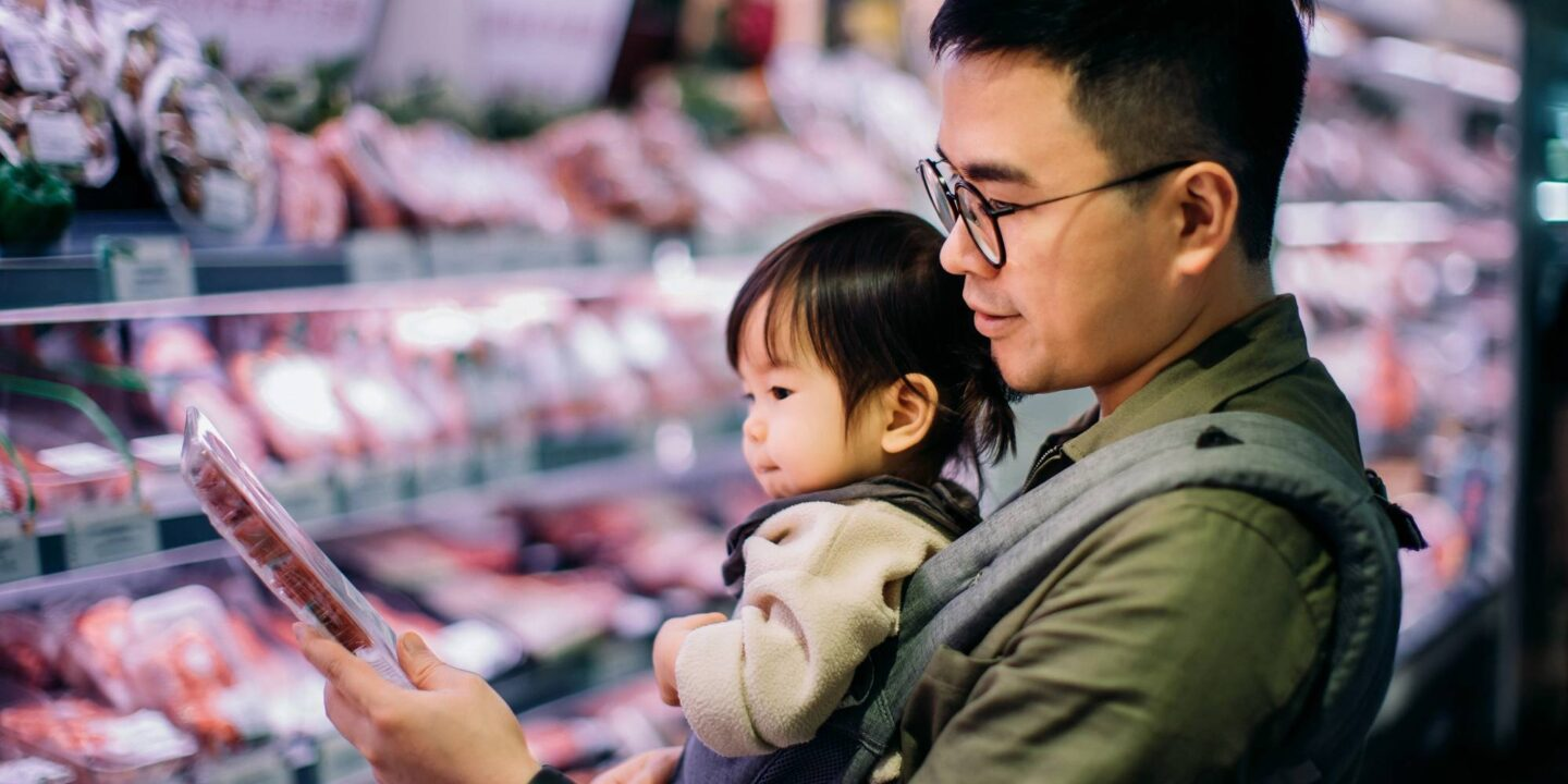 Asian father grocery shopping with daughter - Marking Excellence in Safety through the NSF Mark   NSF International
