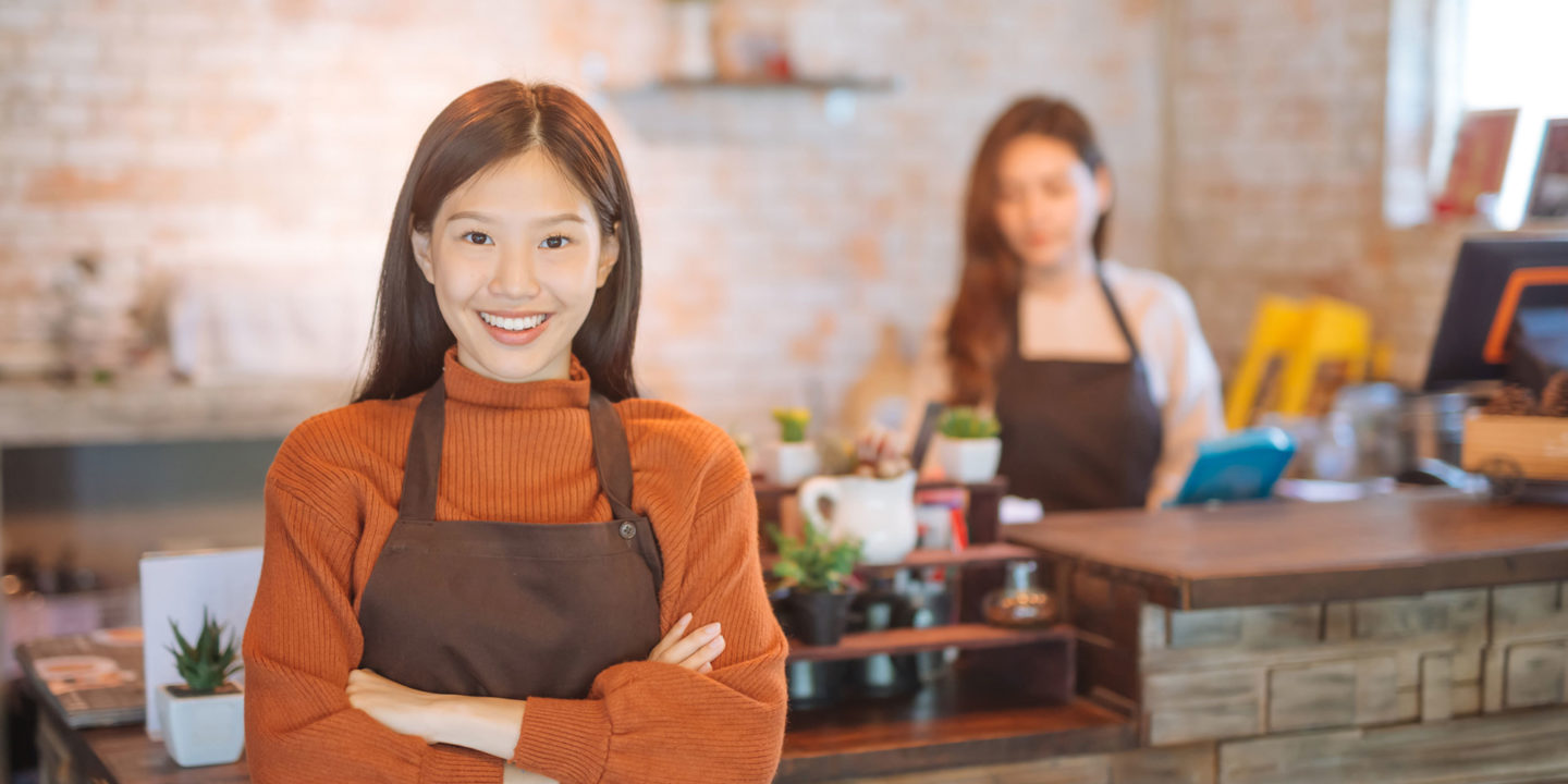 Asian restaurant owner with employee - Food Safety Consulting Services
