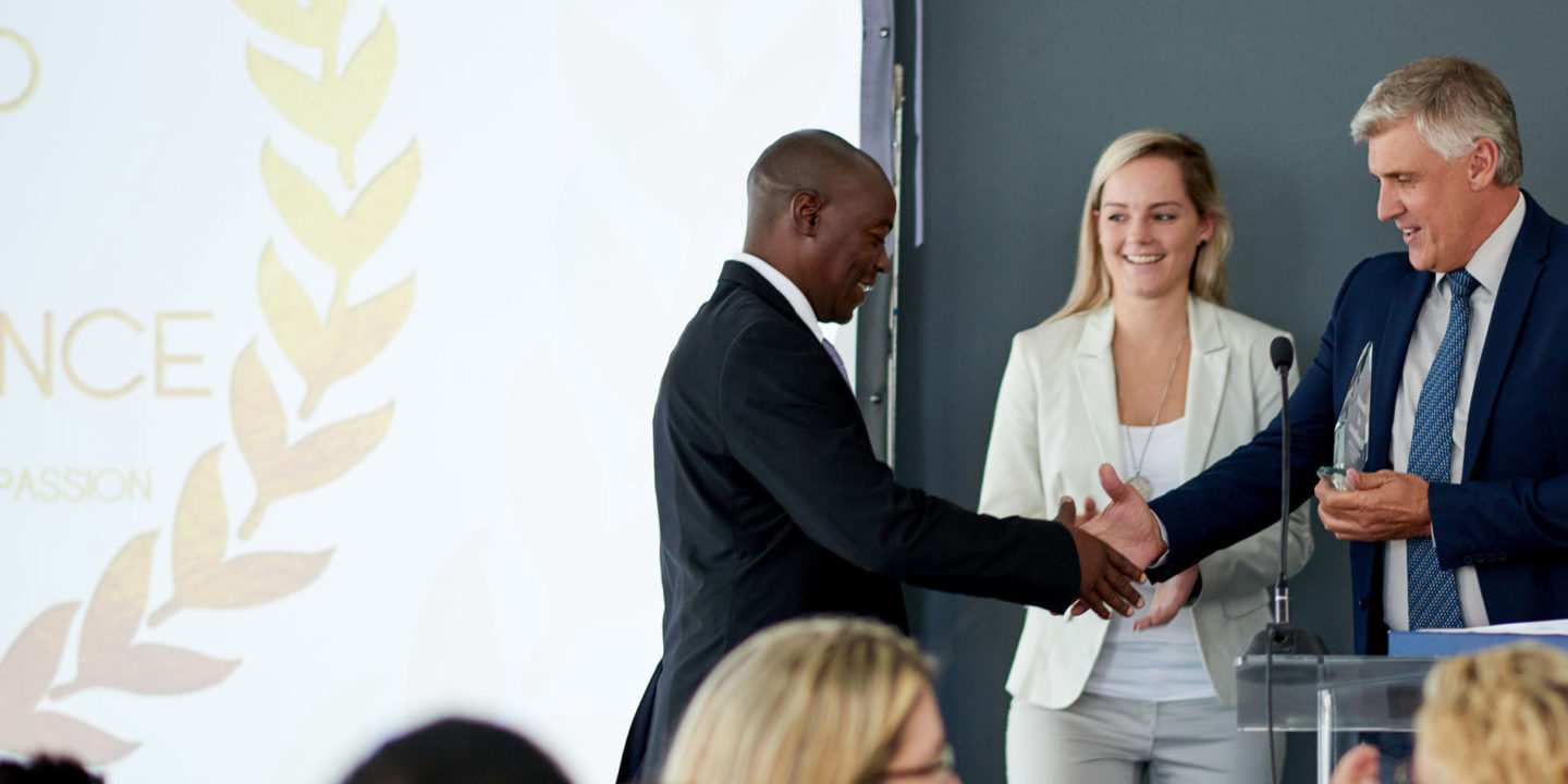 Businessman being awarded a prize during an awards giving ceremony