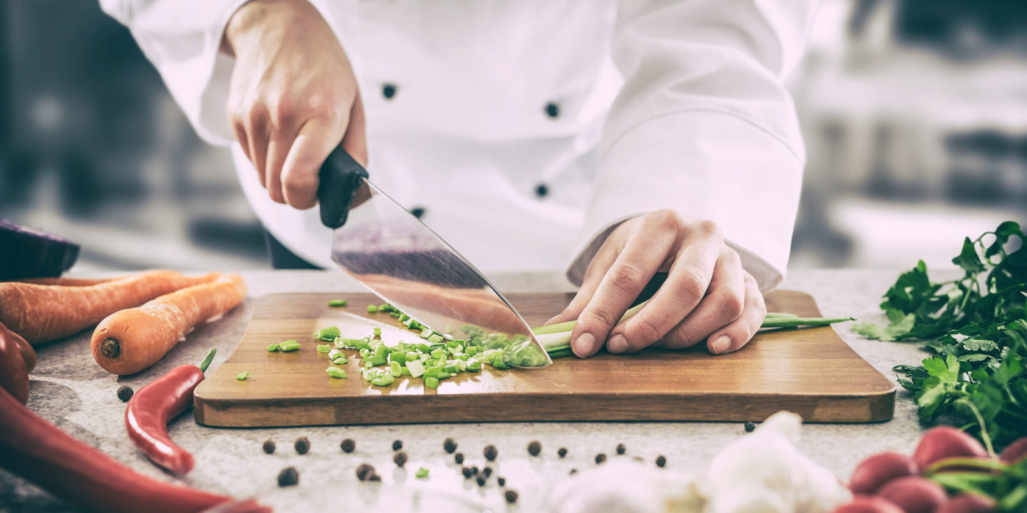 Chef chopping vegetables- Food Consulting Solutions