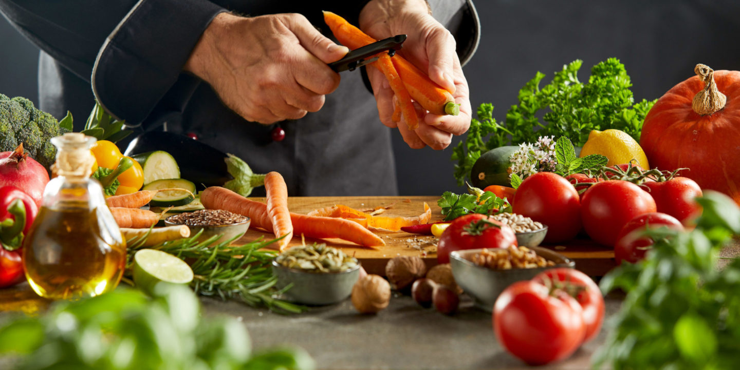 Chef preparing vegetables - Quality Assurance International (QAI) | NSF International