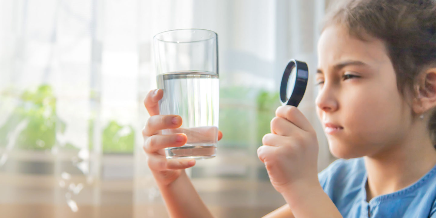 Child inspecting water glass - Prioritizing Children's Health: Revisions to EPA Rules and NSF Standards Help Reduce Lead in Drinking Water   NSF International