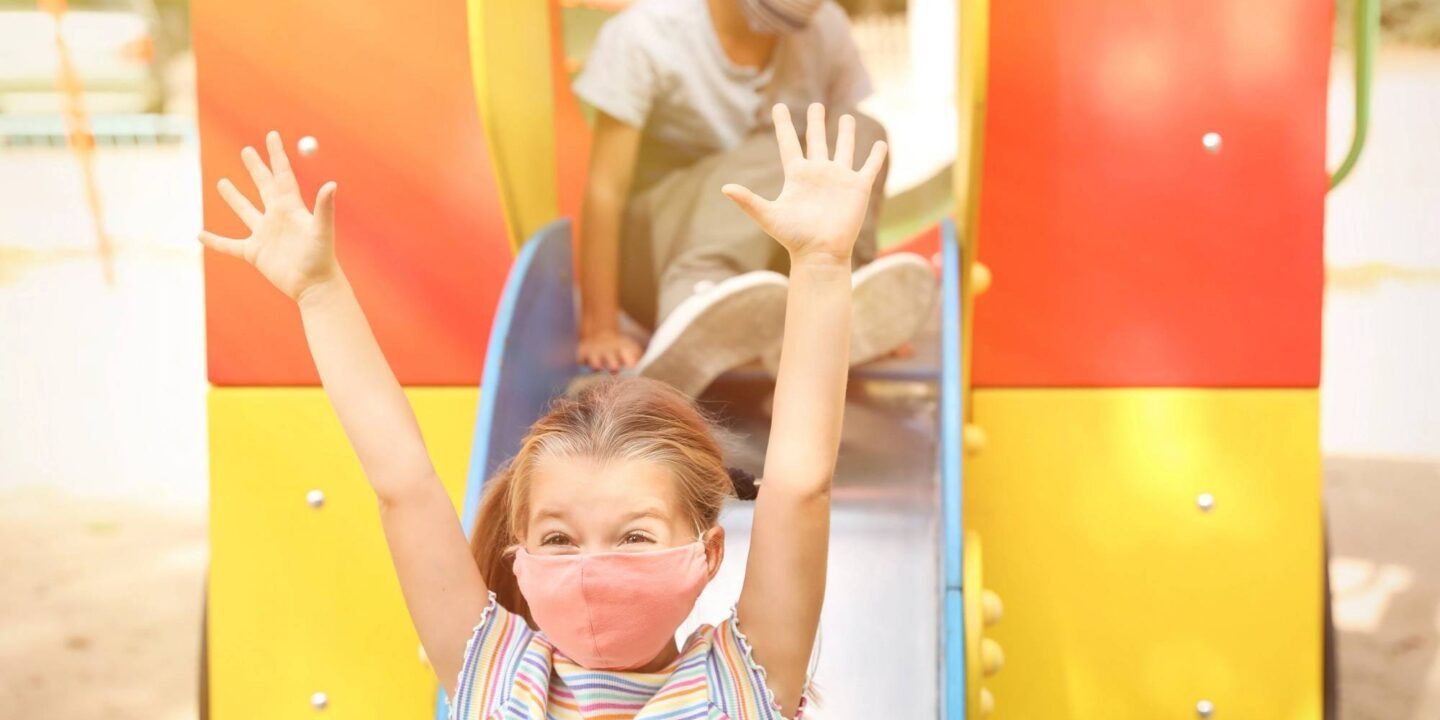 Children on playground with mask - 7 Back to After-School Parental Tips For Kids Safety | NSF International