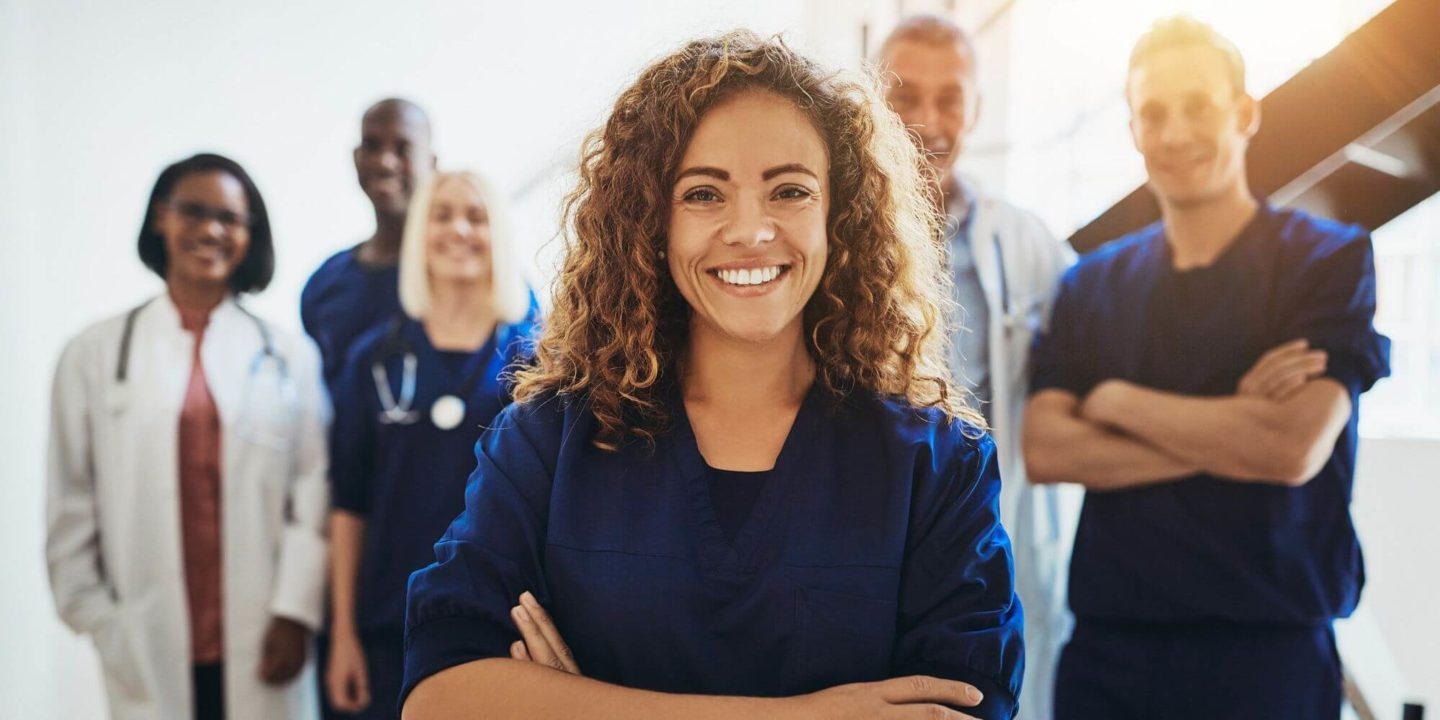 Vaccination clinic staff smiling - NSF Expert Paul Medeiros Helped Slow the Spread of COVID-19 | NSF International