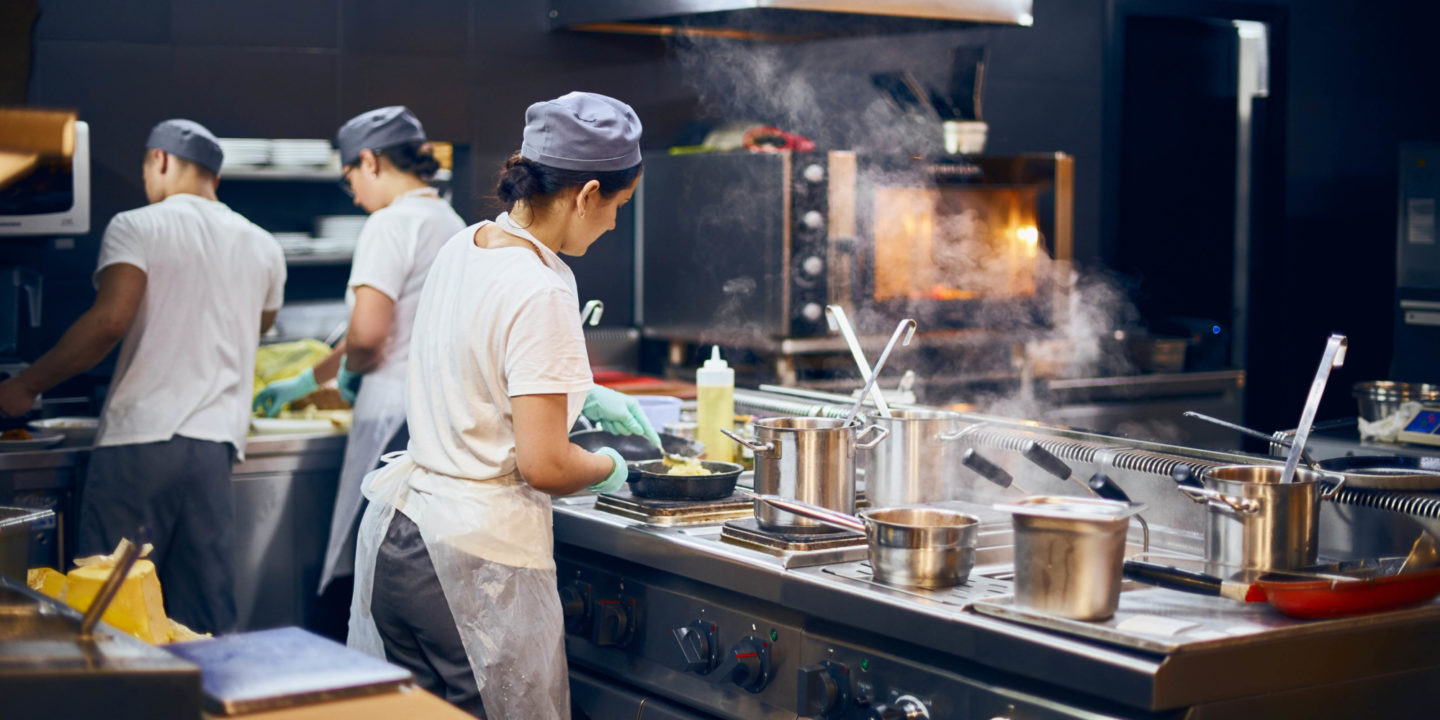 Cooks working in commercial kitchen