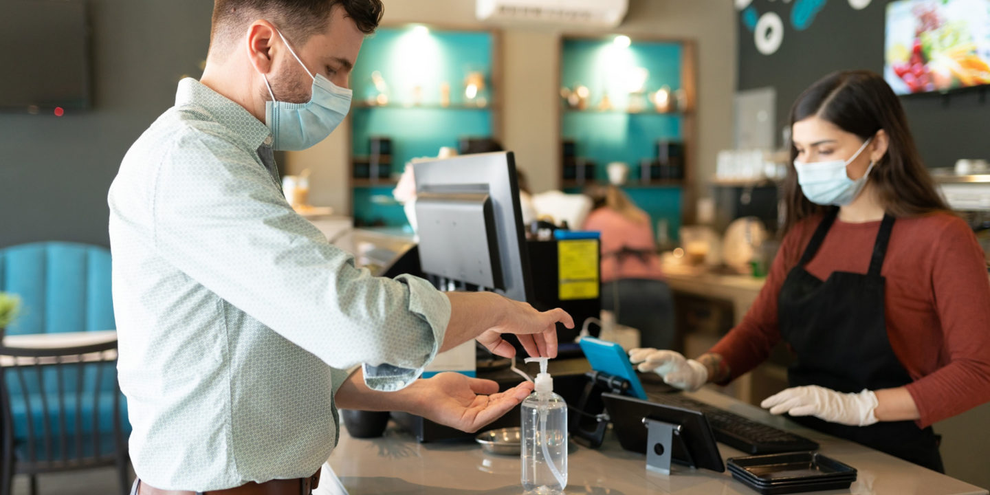 Customer using hand sanitizer -  What Hand Sanitizer Companies Should Know About the Food Industry | NSF International