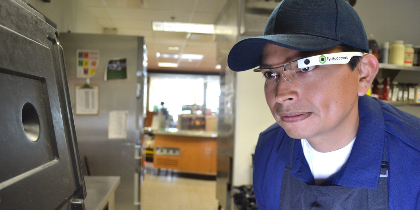 Retail food worker using EyeSucceed glasses to do an inspection