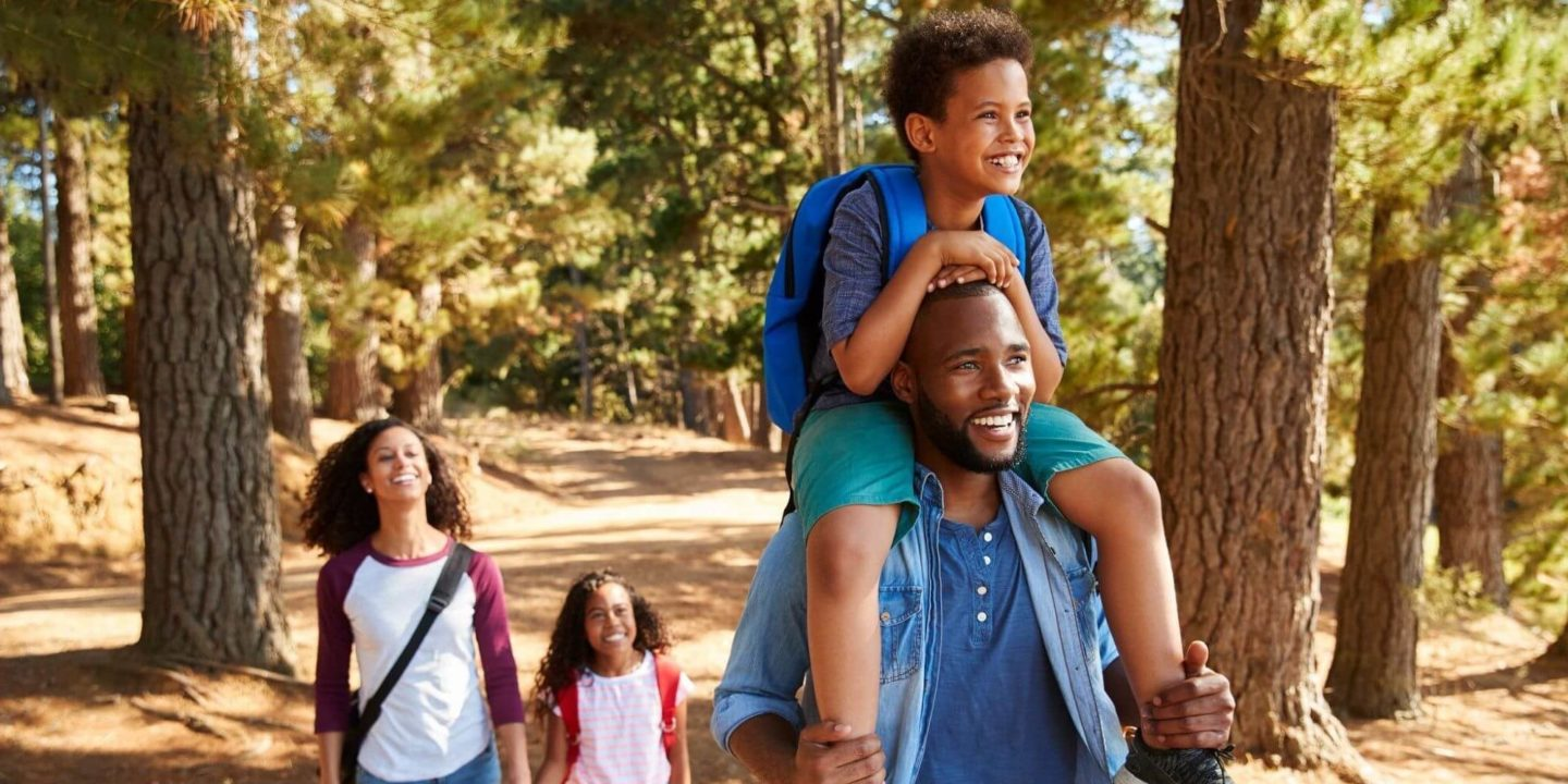 Family hiking - Summer Staycation Safety Ideas | NSF International