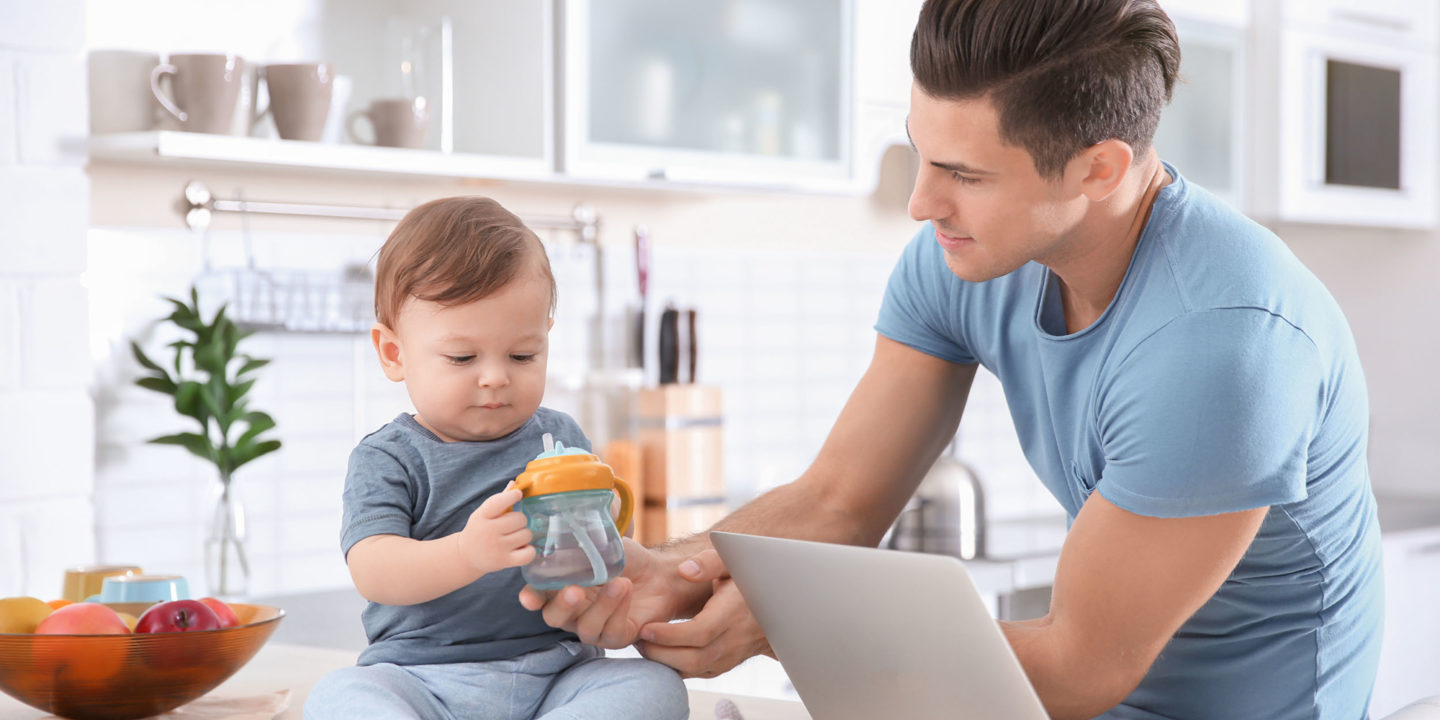 Young father giving bottle of water to his little son at home - Understand Your Water Quality Report | NSF International