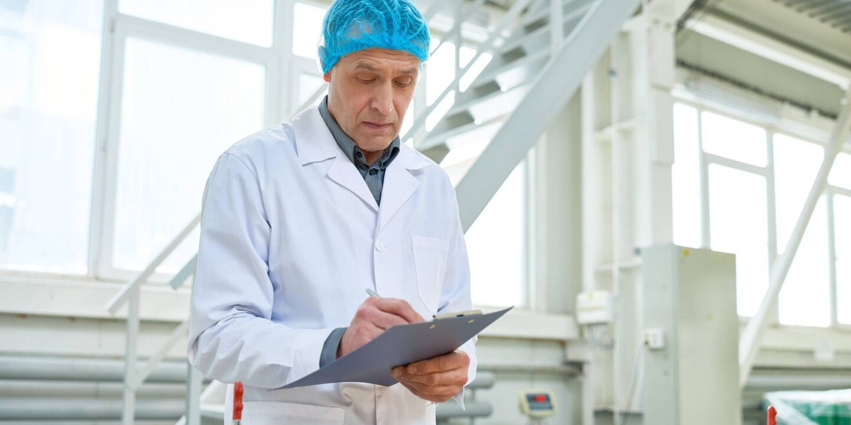 Senior worker in uniform supervising production of food - Food-Grade Lubricants Registrations   NSF International