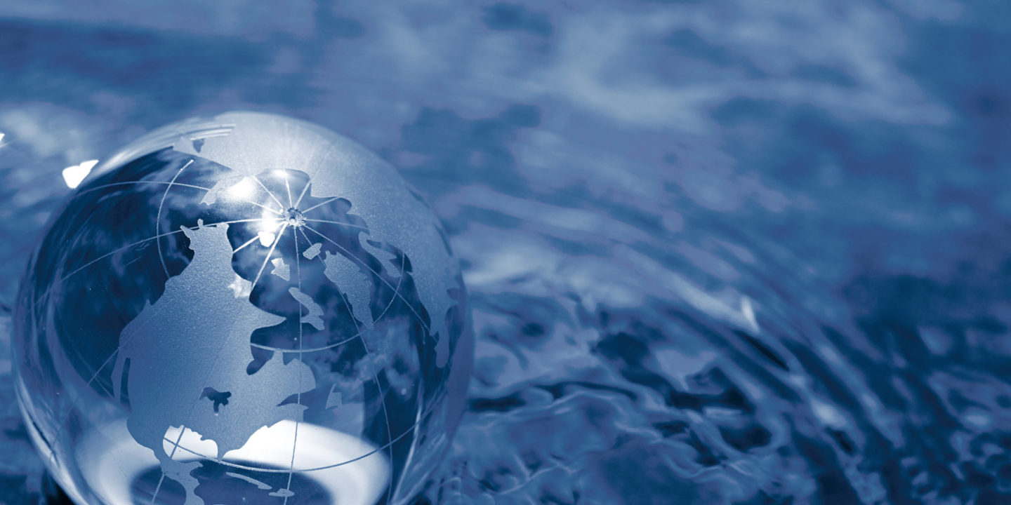 Glass globe sitting in a ripple of water