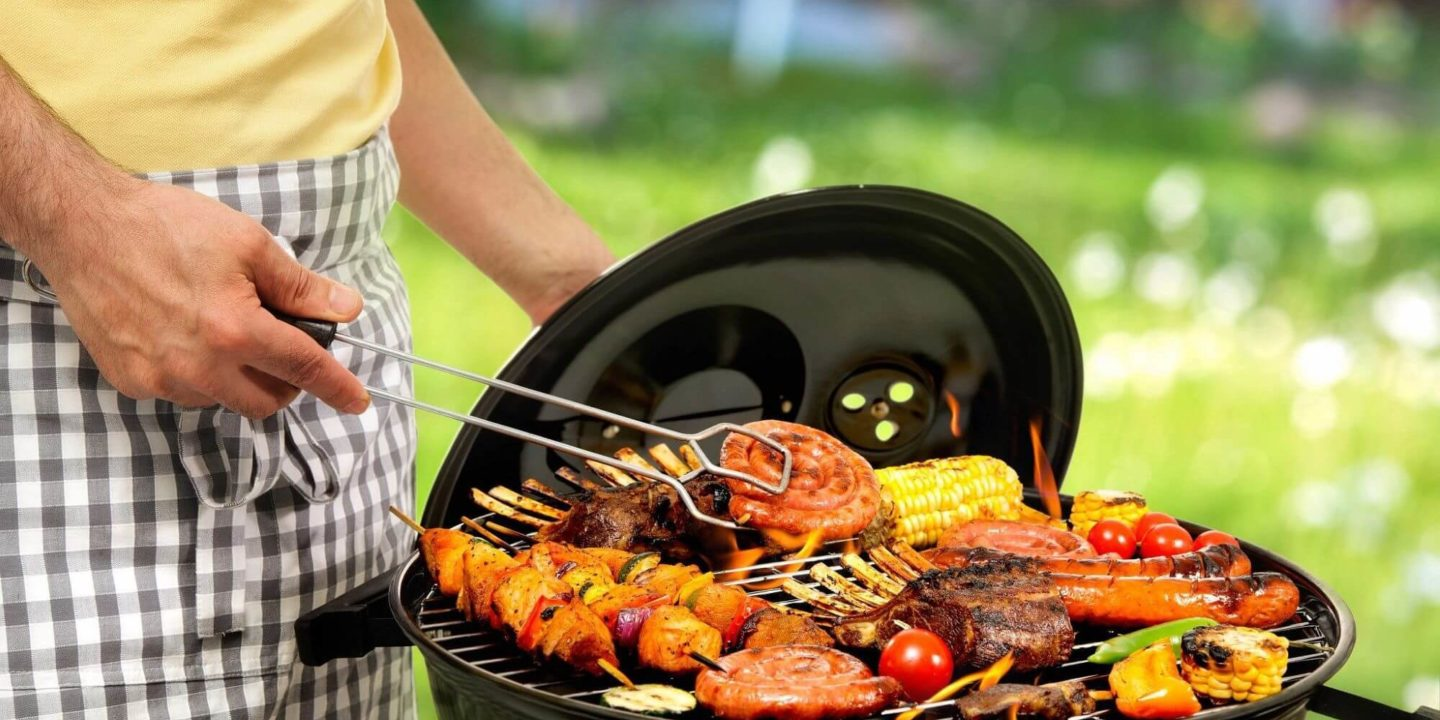 Barbecue grill with meat and veggies - Guide to Safely Firing Up the Barbeque   NSF International