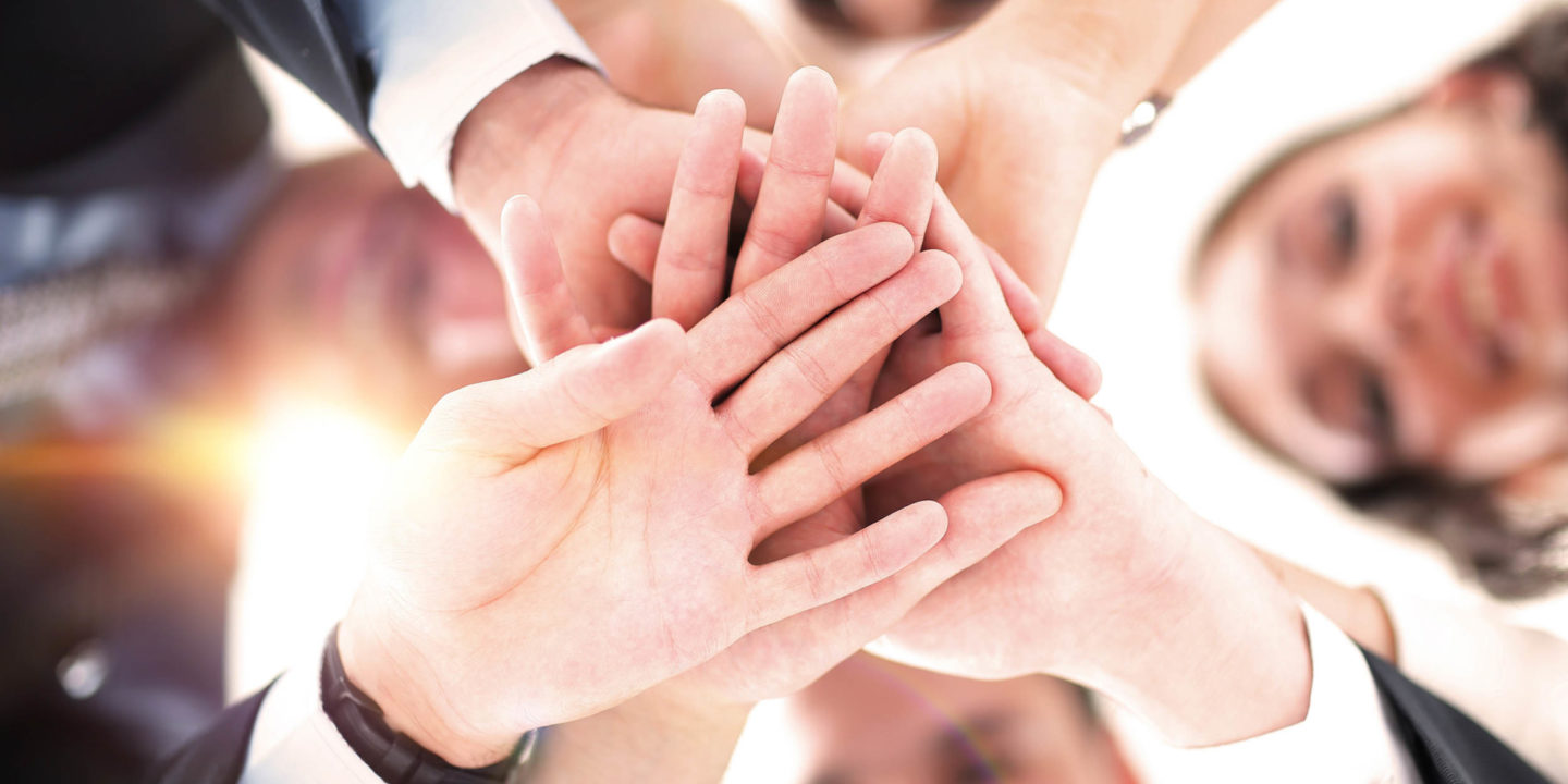 Group's hands from below
