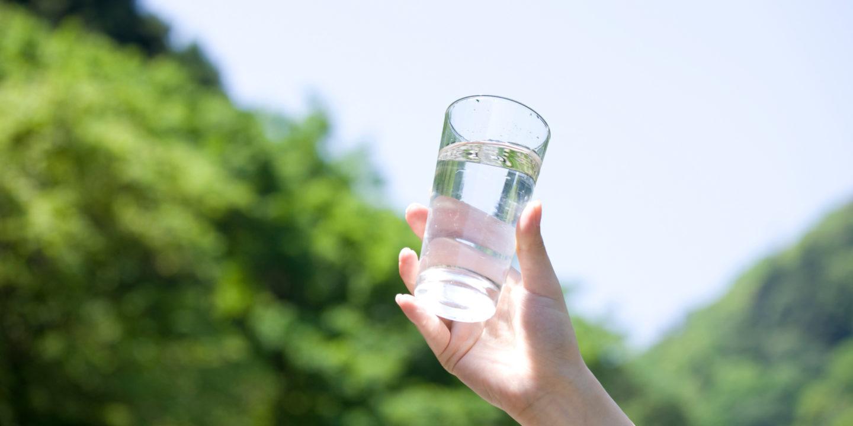 Hand holding glass | NSF International