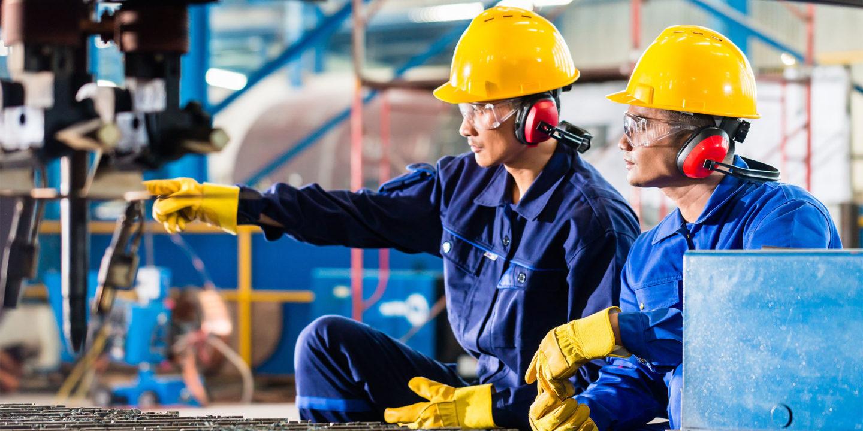 Worker in factory at industrial metal cutting machine - NSF International Strategic Registrations | NSF International